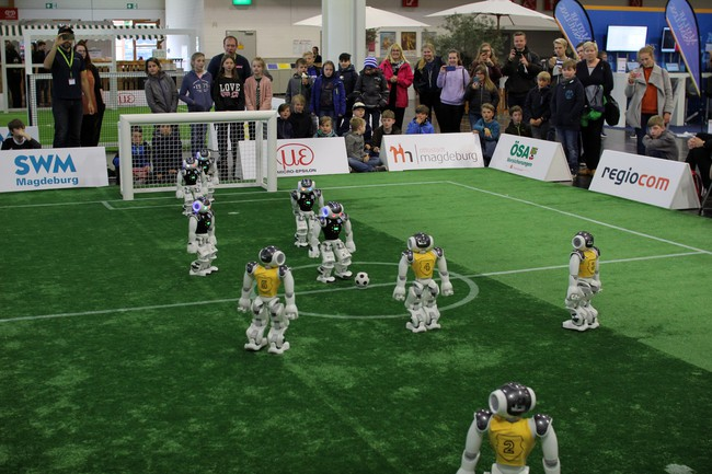 Kickoff in the round robin game against the Nao-Devils Dortmund at the RoboCup German Open 2019.
